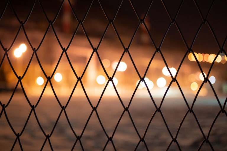 grid fence at night